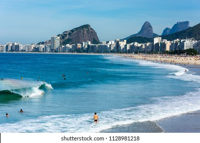 Beautiful view of Leme and Copacabana beach in a sunny day with good small waves.