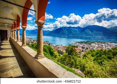 Beautiful view to Locarno city, lake Maggiore (Lago Maggiore) and Swiss Alps from Madonna del Sasso Church in Ticino, Switzerland.