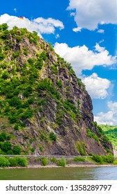 Beautiful view of the Lorelei (German: Loreley), a steep slate rock on the Rhine riverbank in the Rhine Gorge, a UNESCO World Heritage Site, at St. Goarshausen on a nice sunny day with blue sky.