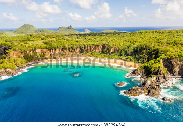 Beautiful view made with drone from sancho beach in fernando de noronha Brazil elected the most beautiful beach in the world for 3 times with a beautiful day, sky and blue sea, lots of sun and nature