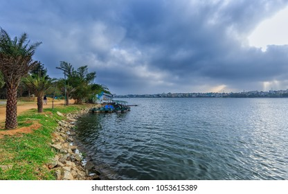 Beautiful view of Madiwala Lake in the morning with striking clouds, Madiwala, Bangalore, Bengaluru, Karnataka, India. Relaxation and holiday concept.