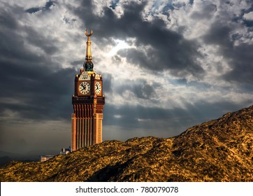 Beautiful view of Makkah Tower, Clock Tower under cloudy sky, top view and dry mountains of holy city of Makkah, Saudi Arabia