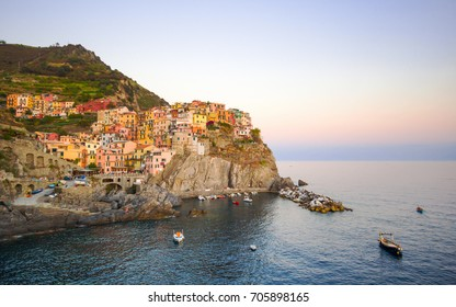 Beautiful view of Manarola one of five famous colorful villages of Cinque Terre National Park in Italy on sheer cliffs, Unesco famous colorful villages in Cinque Terre, Liguria Italy.