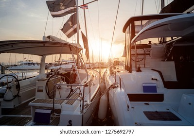 Beautiful view of marina and harbor with yachts and motorboats. Background