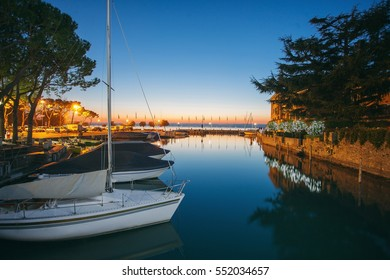 Beautiful view of the Marina: yachts moored near the shore in the evening