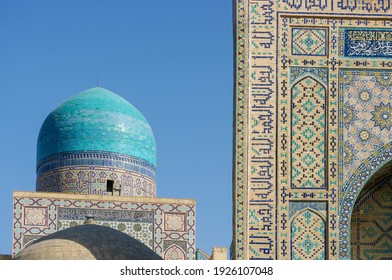 Beautiful view of medieval mausoleums at Shah-i-Zinda necropolis with turquoise tile dome and intricate facade decoration in UNESCO listed Samarkand, Uzbekistan