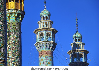 Beautiful view - minarets of Fatima Masumeh (Al-Masumah) Shrine and Masjid Azam Mosque at the background of bright blue sky in Qum (Qom) - the holy city for Shia Muslims, Iran, Middle East