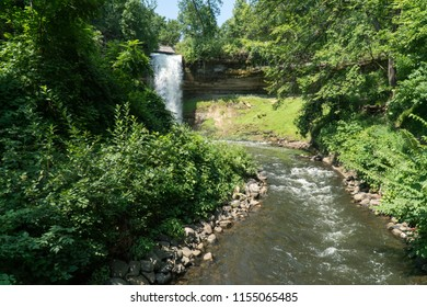 Beautiful view of Minnehaha Falls waterfall in Minneapolis Minnesota during day time in summer. Branch of mississippi river into flowing stream.