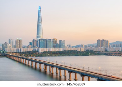 Beautiful view of modern tower at downtown of Seoul in South Korea at sunset. Wonderful skyscraper and Jamsil Railway Bridge over the Han River (Hangang). Amazing cityscape.