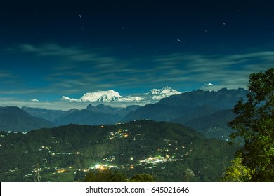 Beautiful view of moonlit Kanchenjungha Mountain Range of great Himalayas, shot in a full moon night. Rinchenpong, Sikkim, India