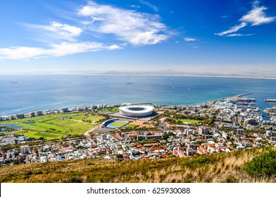 Beautiful view of Mouille Point, Green Point with a football stadium and the V and A (Victoria and Alfred) Waterfront in Cape Town seen from Signal Hill. Sunny day with a few clouds. South Africa.