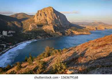 Beautiful view of Mount Falcon and the village of Noviy Svet on the Black Sea coast in Crimea, the golden hour before sunset