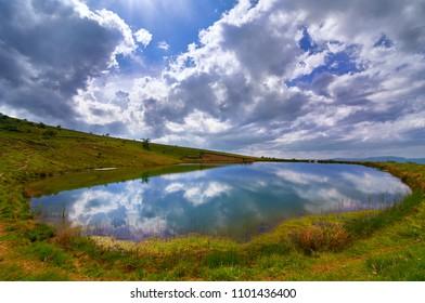 Beautiful view of mountain lake on Kalin Kamen peak in Osogovski mountains in Macedonia.