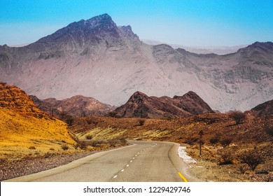 A beautiful view of the mountains and highway in The Sur Oman