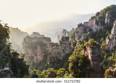 Beautiful view of natural quartz sandstone pillar the Avatar Hallelujah Mountain among green woods and rocks in the Tianzi Mountains, the Zhangjiajie National Forest Park, Hunan Province, China.