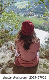 Beautiful view, nature. River and mountain. Girl sitting on rock looking on national park sachsiche schweiz and czech switzerland and river Labe. The view from Bastei bridge.