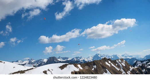beautiful view from nebelhorn mountain to alpine range oberstdorf with smoe snow at the peaks. allgau landscape germany.