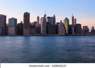 Beautiful view of New York City midtown Manhattan sunset skyline over Hudson River.