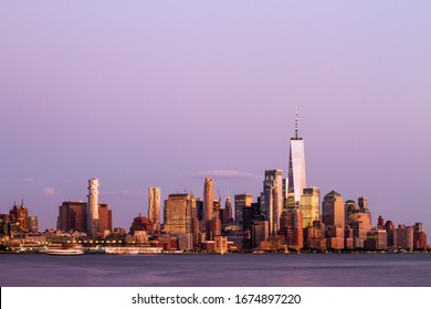 Beautiful view of New York city skyline with waterfront at evening, USA