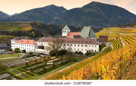 Beautiful view of Novacella Monastery with yellow wineyards, south tyrol, Bressanone, Italy.