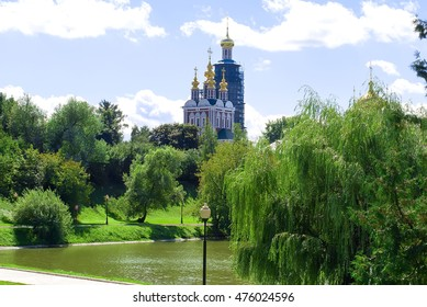 Beautiful view of Novodevichy Convent in Moscow, Russia, view from the lake. Restoration work on the bell tower