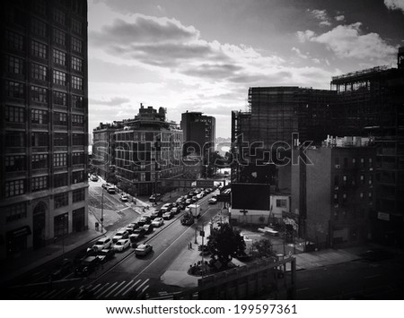 Beautiful view of NYC traffic and buildings at rush hour. Instagram black and white effect filter used.