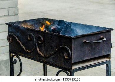 Beautiful view and objects. Beautiful view and background to the burning and hot brazier and fire with smoke, in which to roast meat, and which stands in nature.