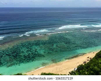 Beautiful view of the ocean from the cliffs to Bali. Sunny day and sea breeze
