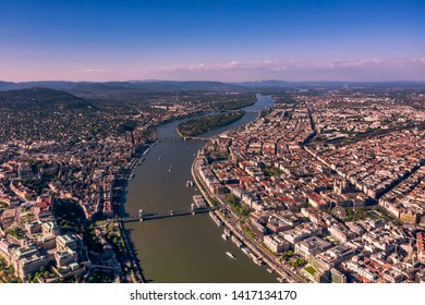 Beautiful view of the old city of Budapest from a height, shot on a drone. In the middle of the Danube river and hain bridge. Panarama with old bilding.