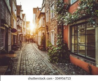 Beautiful view of old town in Europe in beautiful golden evening light at sunset in summer with pastel toned retro vintage Instagram style grunge filter and lens flare sunlight effect