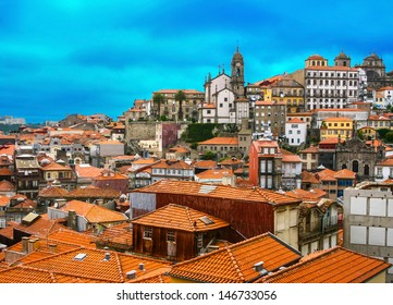 Beautiful view of Old town of Porto in Portugal with beautiful sunset clouds