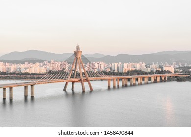 Beautiful view of Olympic Bridge over the Han River (Hangang) at downtown of Seoul in South Korea at sunset. Scenic cityscape. Seoul is a popular tourist destination of Asia.