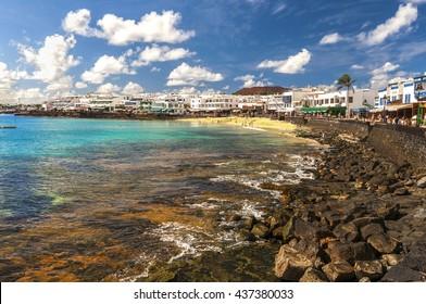 Beautiful view on the Atlantic Ocean on the island of Lanzarote in the village Playa Blanca / View of the promenade in Playa Blanca. Lanzarote. Canary Islands