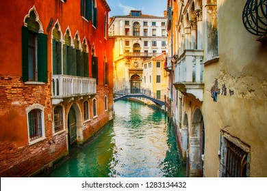 Beautiful view on canal with boats in Venice on sunset, Italy. It is nice summer day in city with historical buildings.