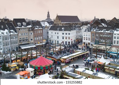 Beautiful view on the city of Maastricht in the Netherlands with a Christmas market on its main square on a snowy winter day
