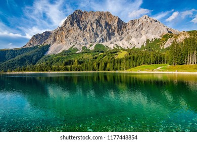 A beautiful view on the Ehrwalder Almsee and the Zugspitze on a sunny summer day in Austria, September 2018