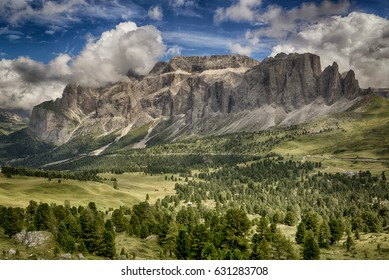Beautiful view on the italian mountains of Val Gardena in summer season seen from path near Sella Pass with sky and clouds at the horizon