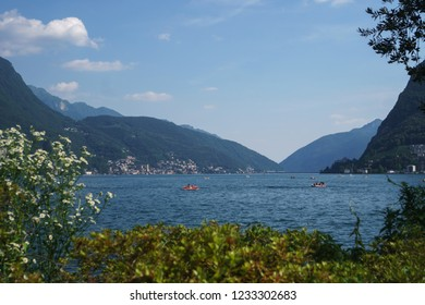 Beautiful view on the Lake Lugano from Parco Ciani on a sunny day in Lugano, Switzerland.