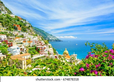 beautiful view on Positano on Amalfi coast with blurred flowers on foreground, Campania, Italy. focus on background