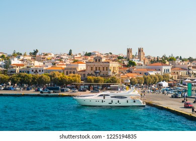 Beautiful view on sea front of greek island Aegina. White yachts standing in the marine port. Greece in summer.