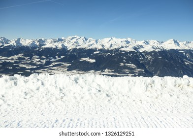 Beautiful view on a snow capped  mountains landscape. Copy space for products placement or text. Plan de Corones, Kronplatz, South Tyrol, Dolomites alps, Italy. Winter time and sunny day