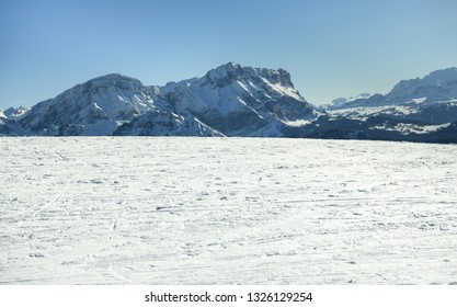 Beautiful view on the snow capped  mountains with texture of ski trails and tracks at ski resort. Copy space for products placement or text. Plan de Corones, Kronplatz, South Tyrol, Dolomites alps