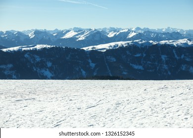 Beautiful view on the snow capped  mountains with texture of ski trails and tracks at ski resort. Copy space for products placement or text. Plan de Corones, Kronplatz, South Tyrol, Dolomites alps.