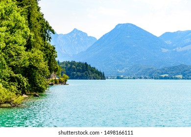 Beautiful view on Wolfgangsee lake by in St Sankt Gilgen with alps mountains. Salzkammergut, Salzburg, Austria