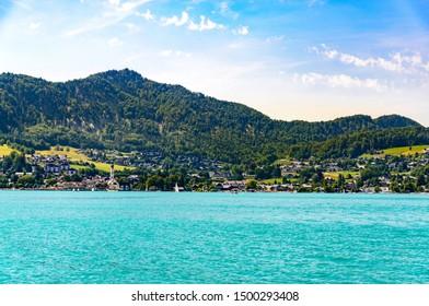 Beautiful view on Wolfgangsee lake by in St Sankt Gilgen with alps mountains, Zwolferhorn mountain, boats, Sailboats. Salzkammergut, Salzburg, Austria