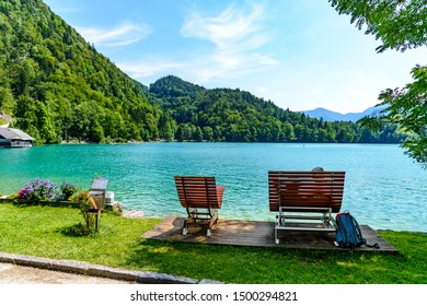 Beautiful view on Wolfgangsee lake by in St Sankt Gilgen with alps mountains, boats, Sailboats. Salzkammergut, Salzburg, Austria