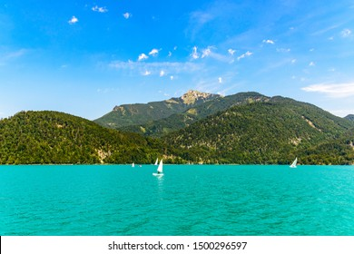 Beautiful view on Wolfgangsee lake by in St Sankt Gilgen with alps mountains, Schafberg mountain, boats, Sailboats, blue sky, clouds. Salzkammergut, Salzburg, Austria