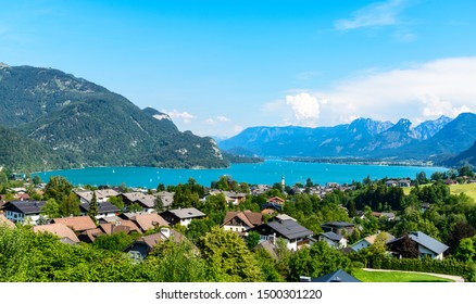 Beautiful view on Wolfgangsee lake by in St Sankt Gilgen (town where Mozart mother born) with alps mountains, blue sky, clouds. Salzkammergut, Salzburg, Austria