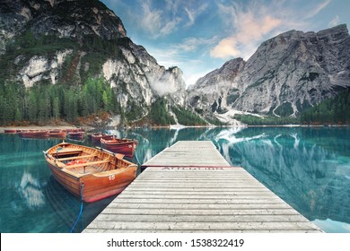 beautiful view on wooden pier with boats in the mountains