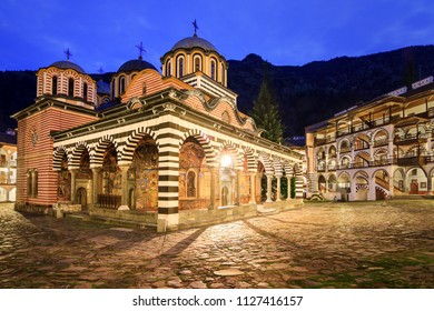 Beautiful view of the Orthodox Rila Monastery, a famous tourist attraction and cultural heritage monument in the Rila Nature Park mountains in Bulgaria in the blue hour at night